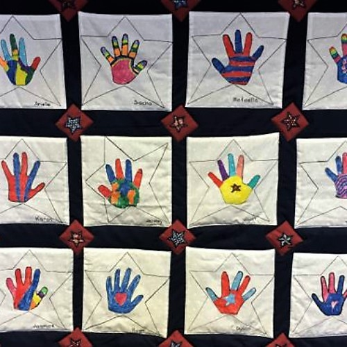 Kindergartners create quilt of valor for Operation Mend program