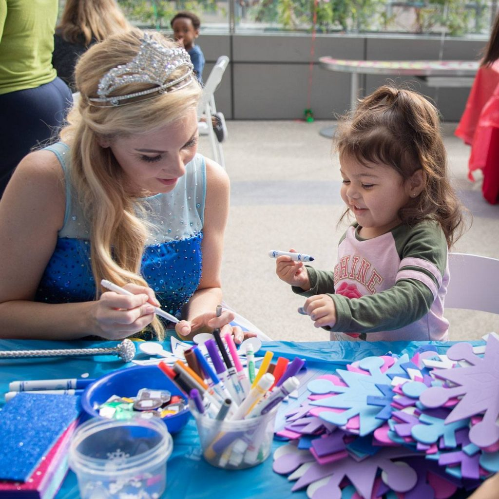 Barbie making crafts with patients