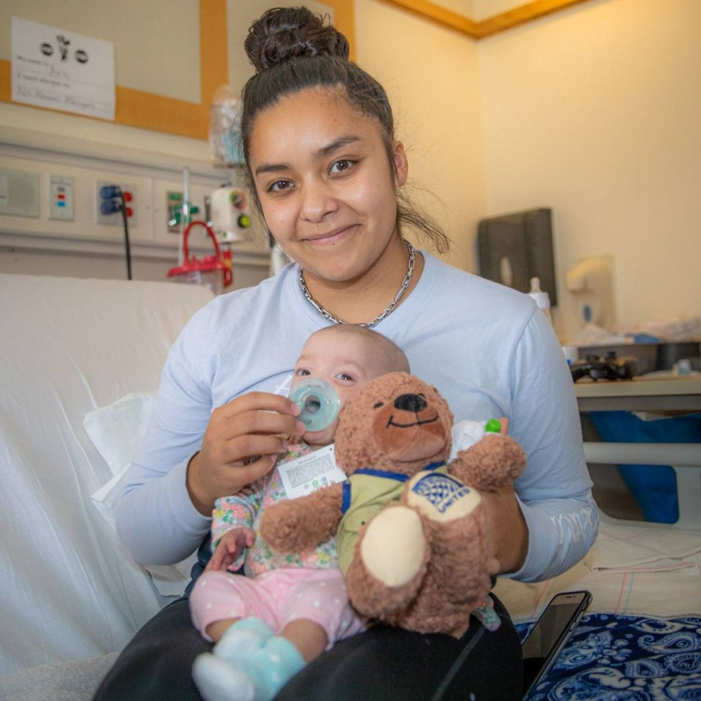 Patient with newborn patient and teddy bear