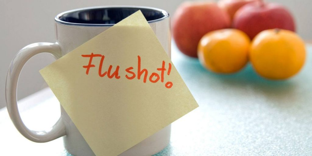 Image of flu shot reminder post-it note