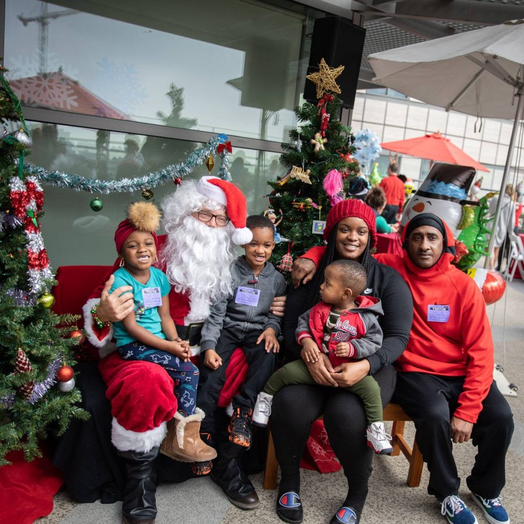 UCLA Mattel Children's Hospital patient with family and Santa