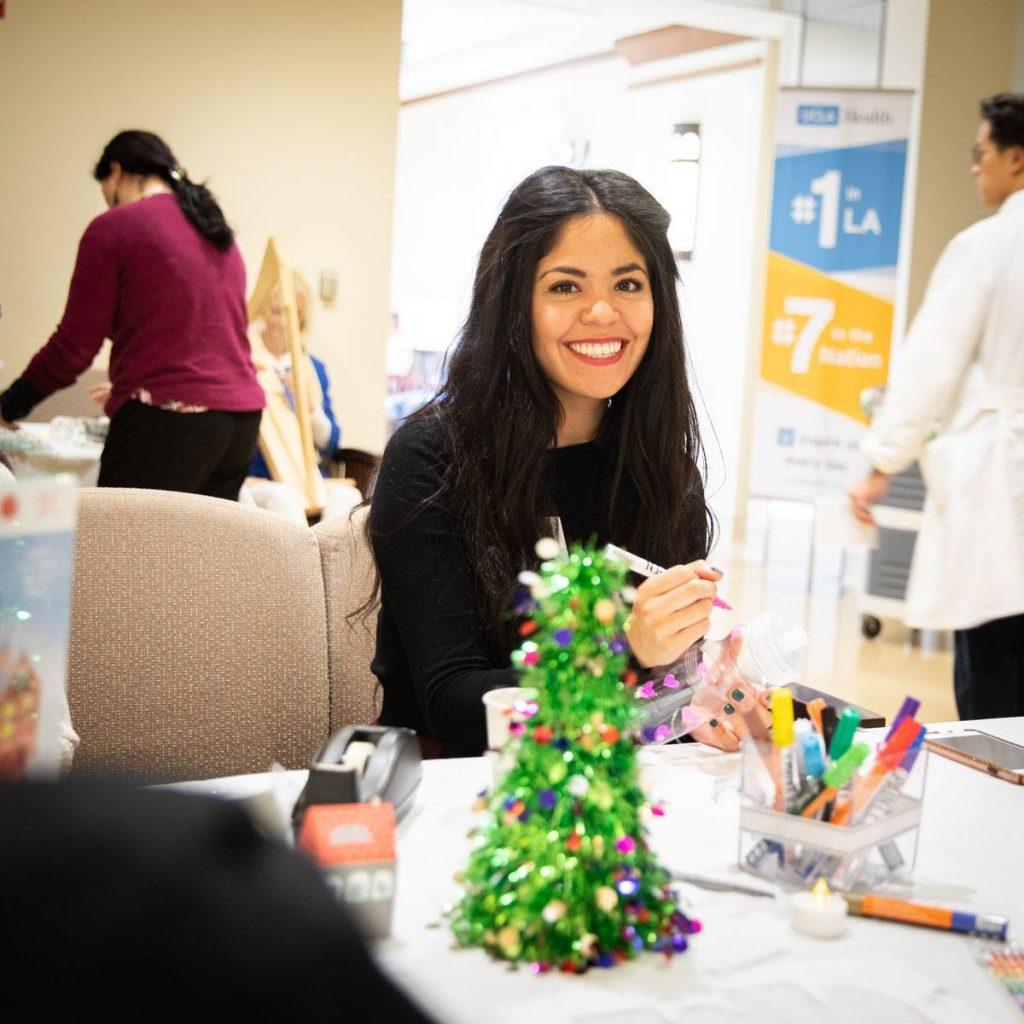 UCLA employee making holiday crafts