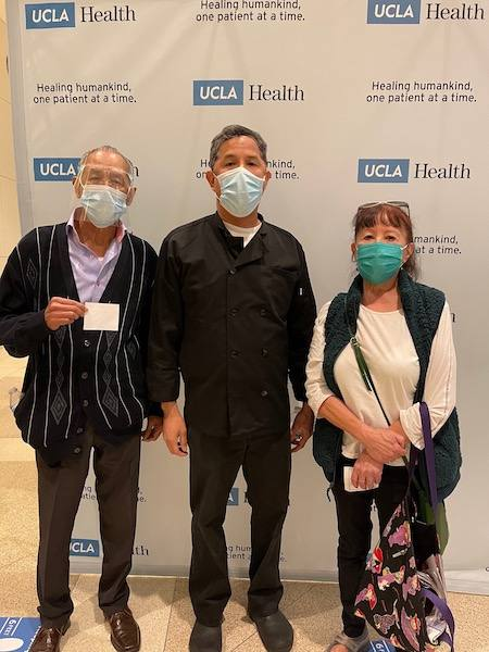 Mark Corona, a UCLA Health Nutrition Services cook, brought his parents in for the family COVID-19 vaccine event on Sunday, Feb. 21, 2021. (Photo by Ellen Pollack)