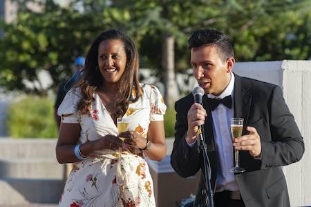 Woman and man speak at graduation celebration