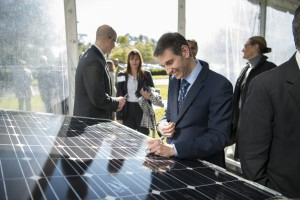 Mayo Clinic Vice President Gianrico Farrugia, M.D., Ph.D., signs solar panels to be erected as part of the Lung Restoration Center on the Florida campus in Jacksonville.
