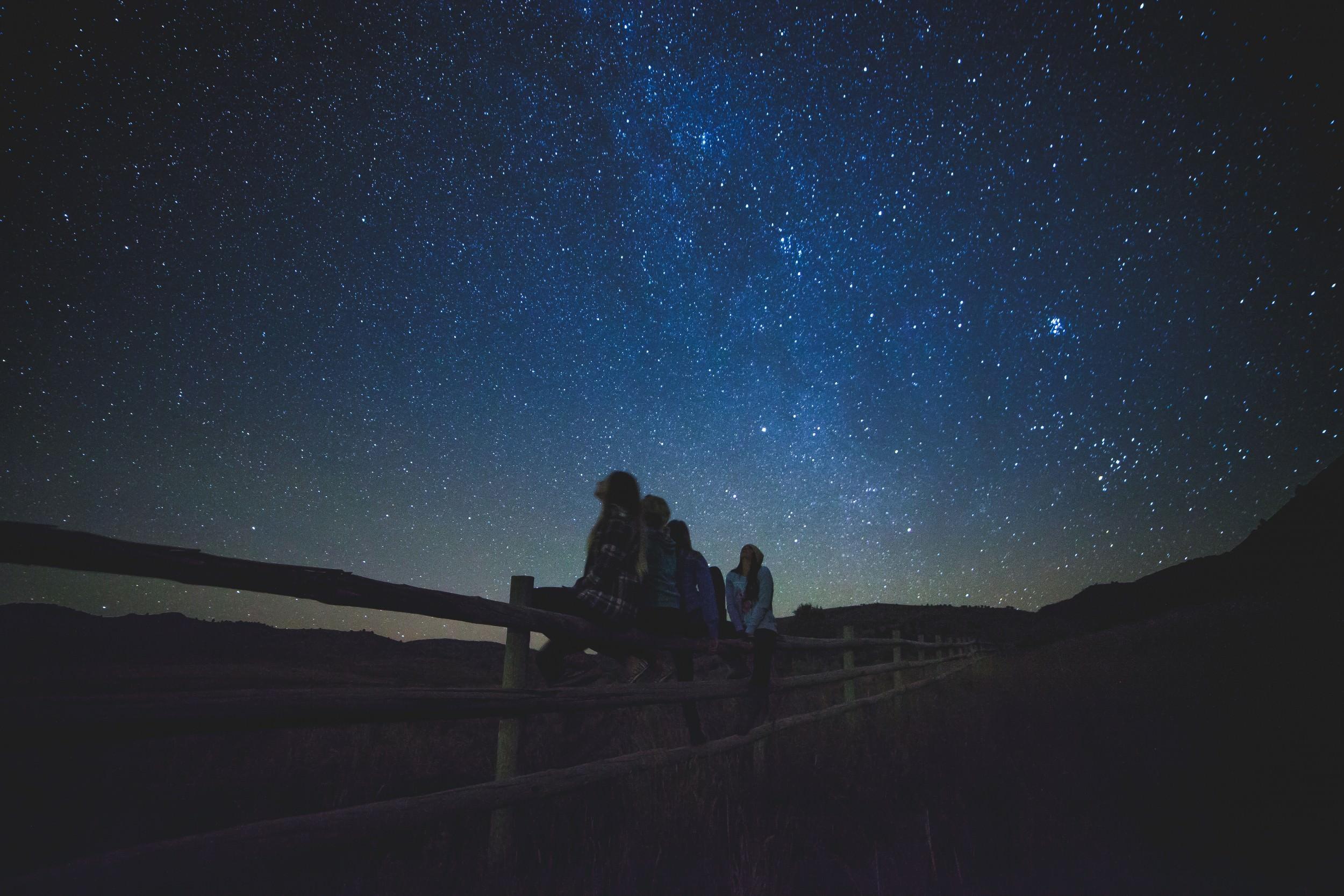 night sky with people. unsplash