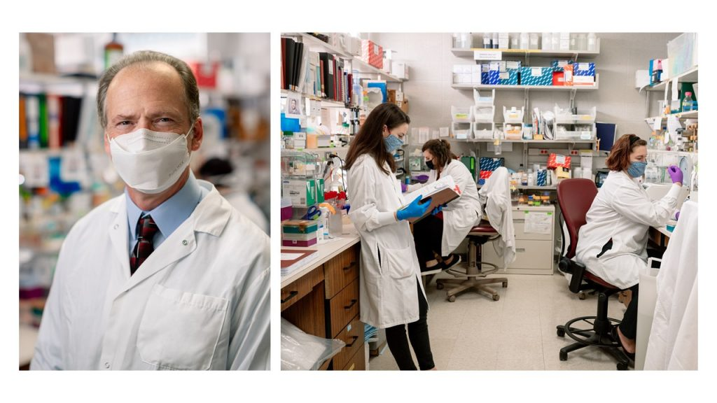 Michael Barry, left, and his lab.
