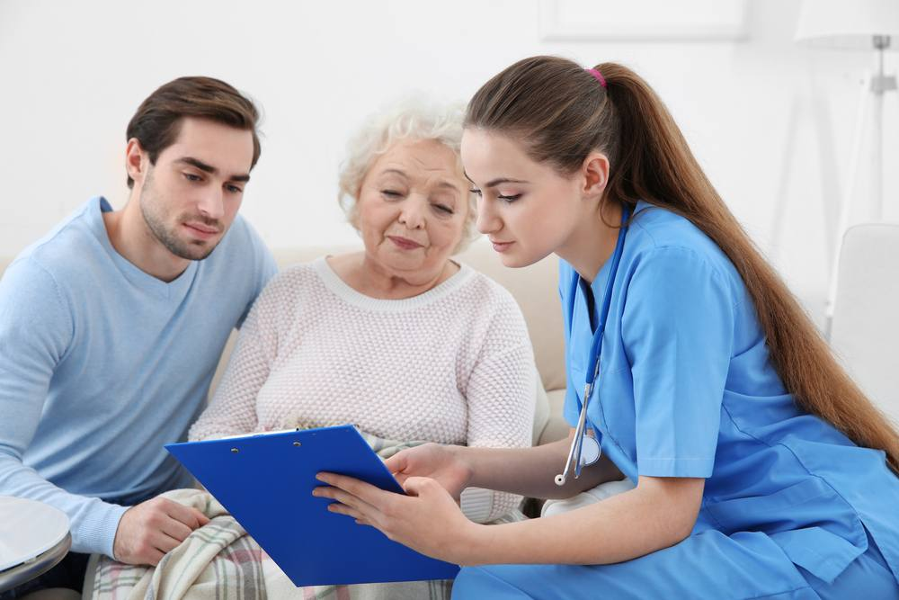 stock photo of nurse meeting with elderly woman and her grandson