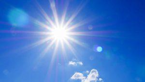 Sun shining in clear blue sky