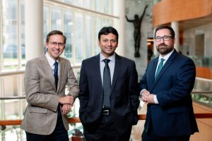 Jeff Anderson, Bharath Wootla and Nathan Wiederman pose in the Gonda Building lobby.