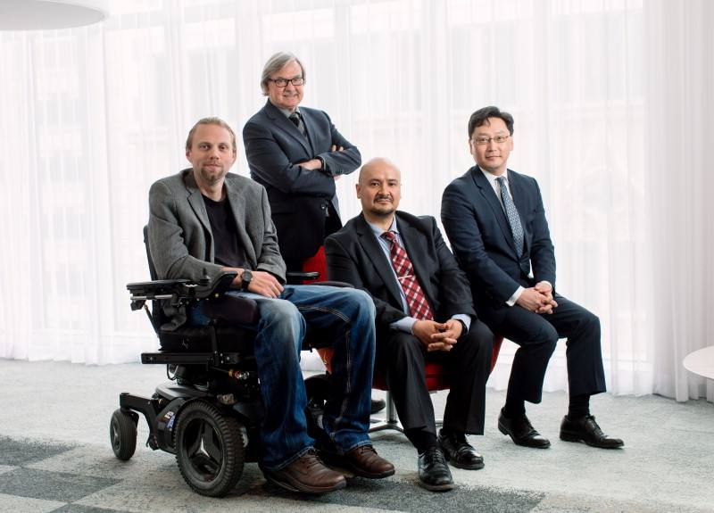 Peter Grahn, Ph.D., poses sitting with Anthony Windebank, M.D.; Luis Lujan, Ph.D.; and Kendall Lee, M.D., Ph.D.