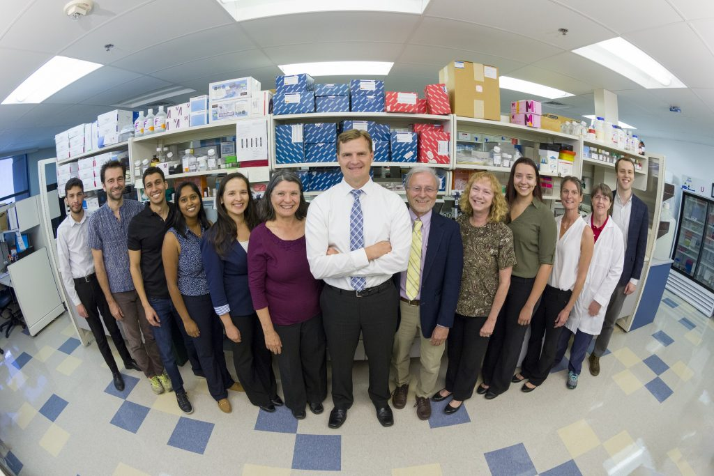 team of people in lab supply area