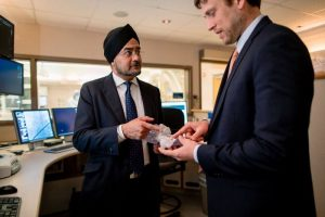 Charanjit Rihal, M.D. (left) with Thomas Foley (right) examining a 3-D model of a heart