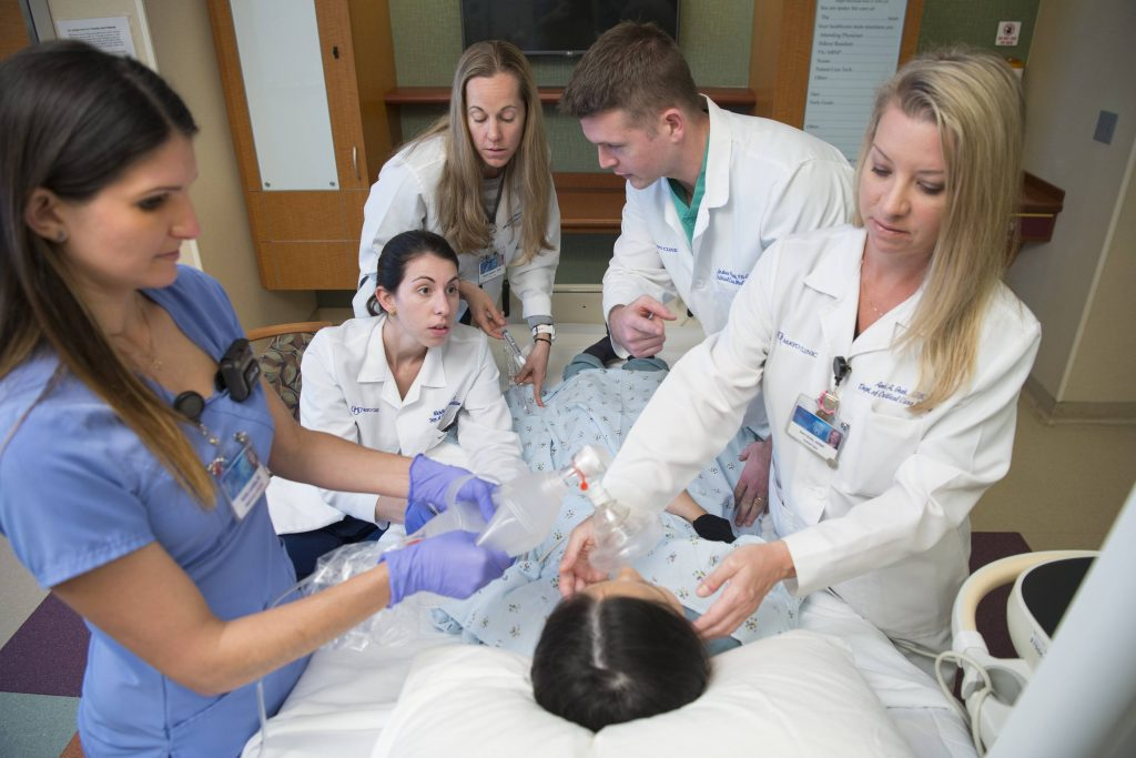 student team simulating intensive care activities for simulated patient