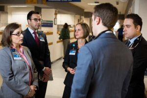 diverse group of resident physicians in clinical hallway at Mayo Clinic