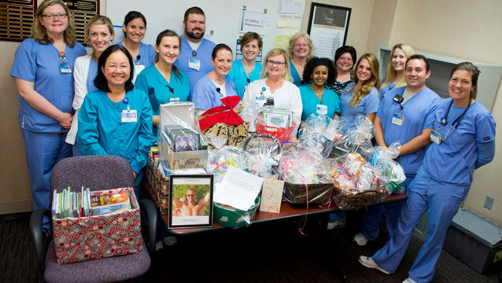 The staff at 3 North with donated gift baskets.