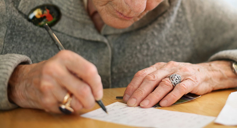 Image of elderly woman writing