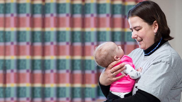 Jamie Snow holding baby Jezzabella.