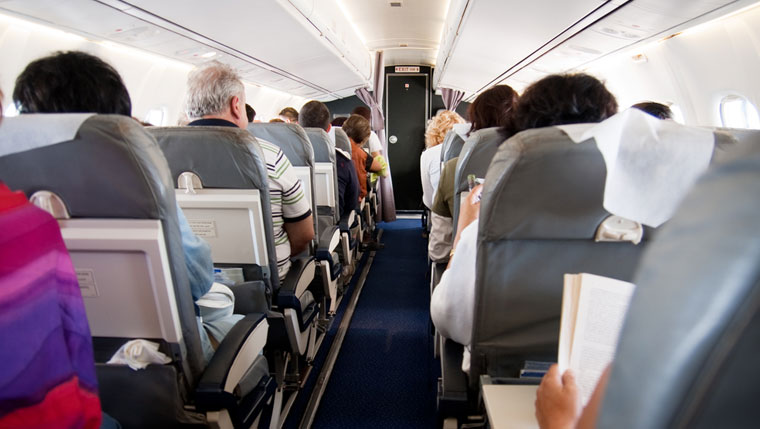 Image of passengers in an airplane cabin
