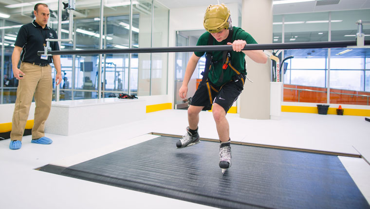 Young athlete on skating treadmill.