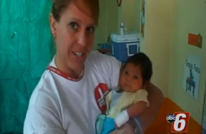 Angie Deml with a young patient in Columbia.
