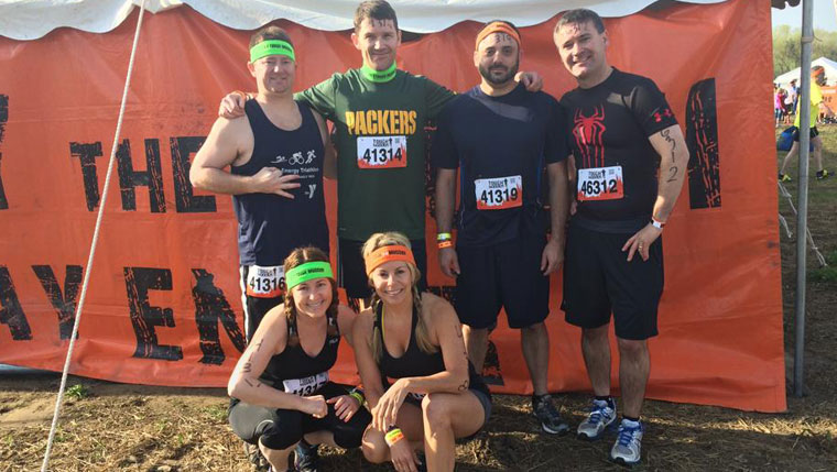 Tough Mudders: Keith Torgerud, Chad Thurman, M.D., Tom Di Iorio and  Will Schanhofer, M.D. Bottom row, left to right, are Angie Torgerud and Stephanie Holmes.