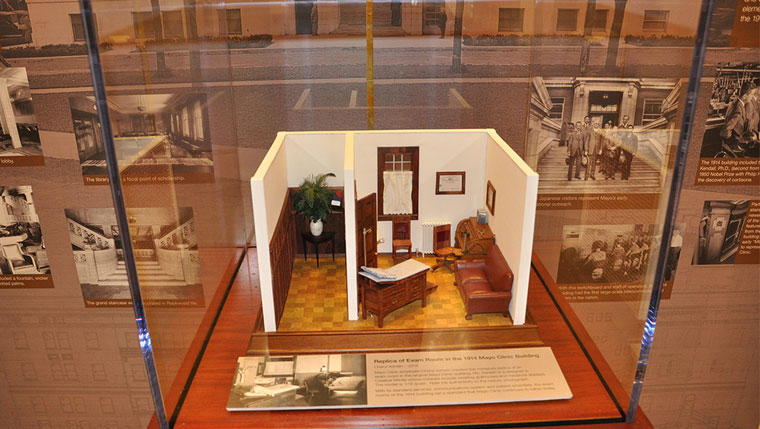 A miniature scale model of an exam room from the 1914 Mayo Clinic Building is the centerpiece of a historical display.