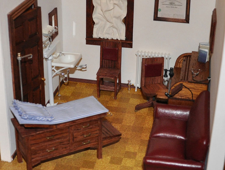 The interior of an exam room from a scale model of the 1914 Mayo Clinic Building.