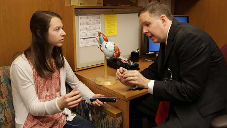 Olivia Craker talks with her pediatrician about the procedures that saves her life one year ago.