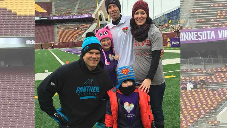 Greg Olsen of the Carolina Panthers meets with young Ryder Smith and his family.