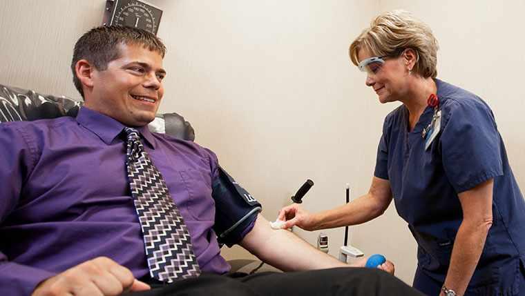 gentleman donating blood at blood bank