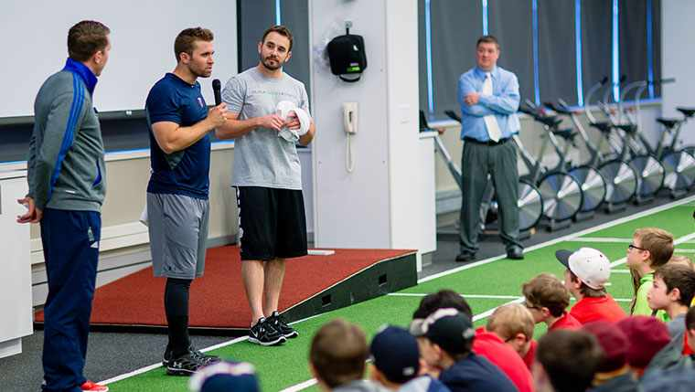 Minnesota Twins baseball players talking to young athletes at the Mayo Clinic Sports Medicine Center.
