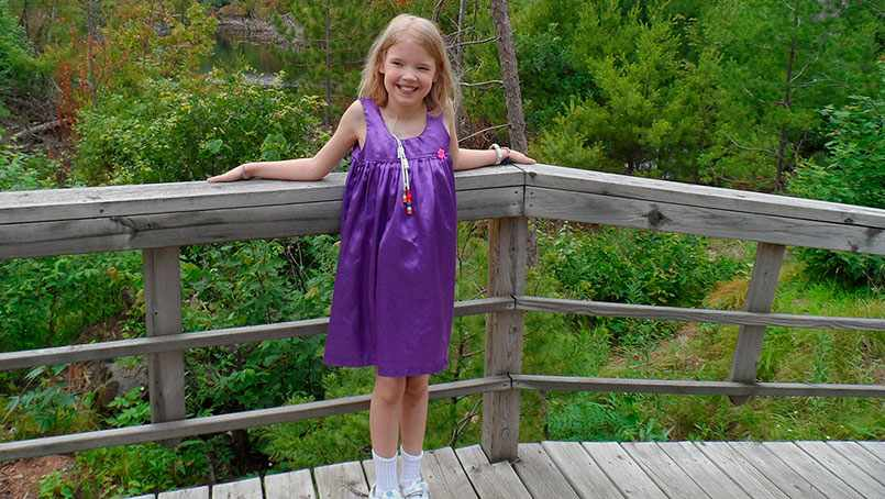 Young child in a purple dress