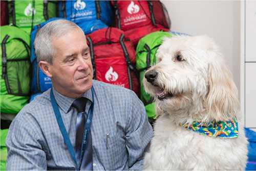 Dr. Graff with Hasbro, a pet therapy dog.