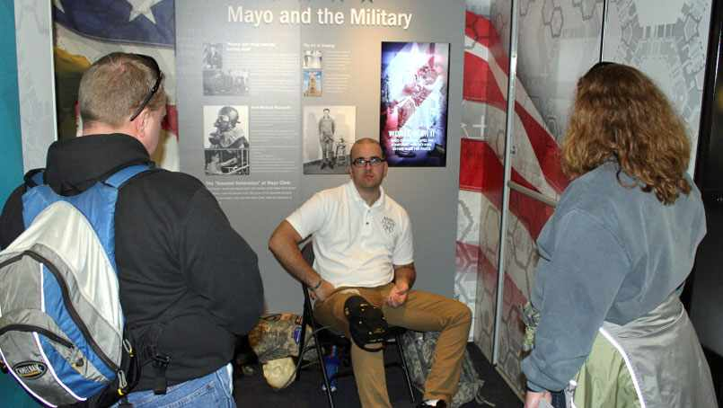 Patrick Zeigler talks with visitors at the Mayo Clinic mobile exhibit.