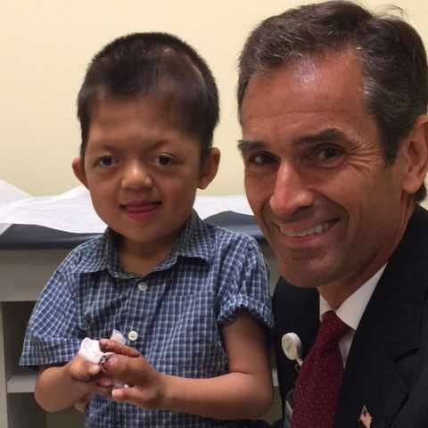 Jianfeng with Dr. Peter Murray after Dr. Murray separated Jianfeng's fingers.