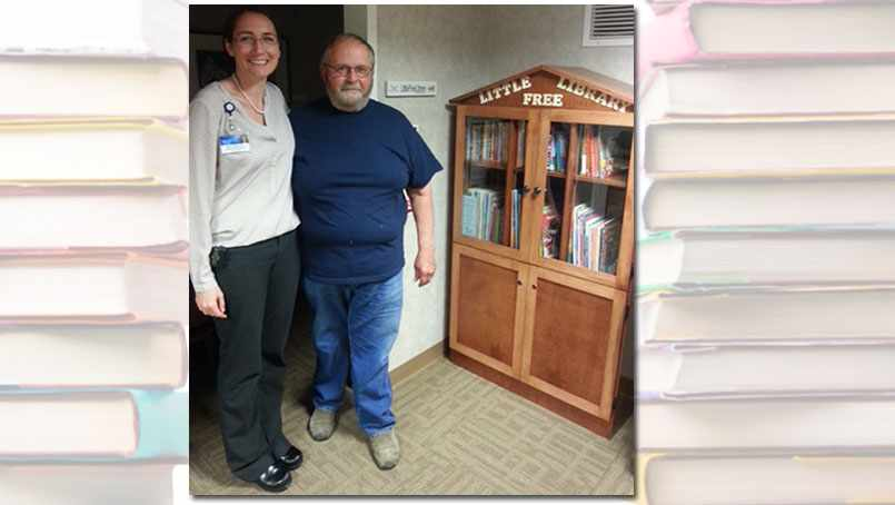 Dr. Tsigonis with Jim Doerre, a retired cabinet maker, who made the Little Free Library.
