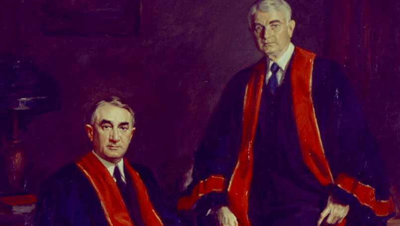 Historical image of Drs. Charlie and Will Mayo in their commencement gowns.