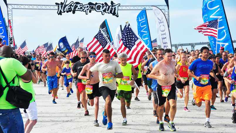 Runners take to the beach at a recent Never Quit event.