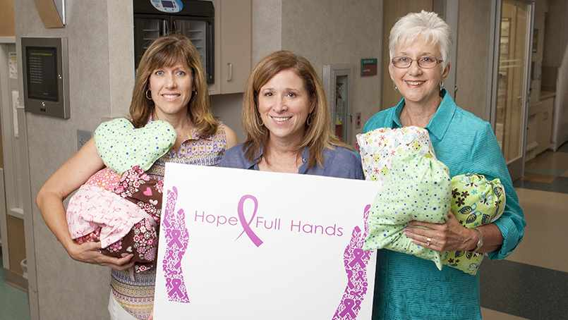 "Debbie Sheppard with HopeFull Hands volunteers make ""Comfort Kits"" for breast cancer patients."