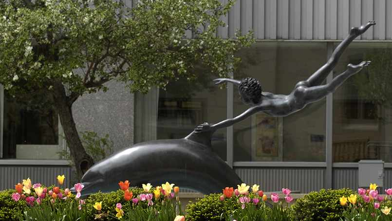 "An X-ray was taken of the bronze ""Boy with a Dolphin"" sculpture to understand the full extent of the boy's wrist injury."