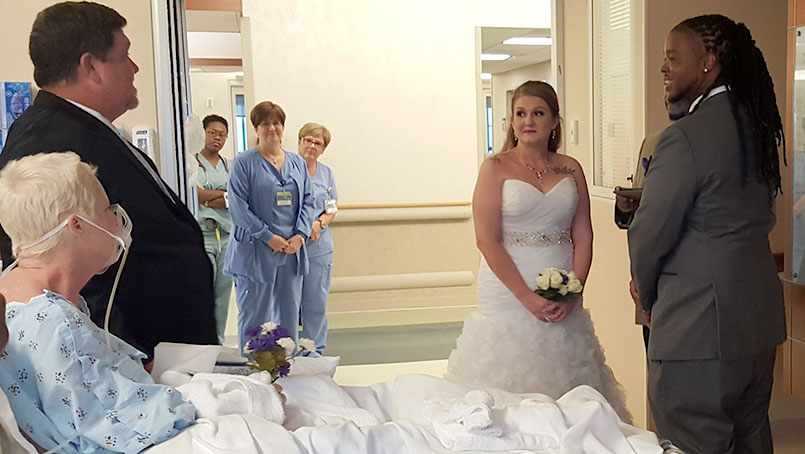 """Music echoed down the hallway of the 4th floor of the Davis Building, as Dave Smith escorted his daughter down the """"aisle"""" and into her mother's hospital room."""