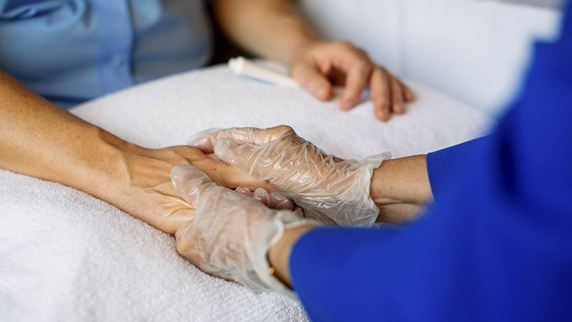 Volunteer Services began offering its Caring Hands hand massage program to patients back in 2006.