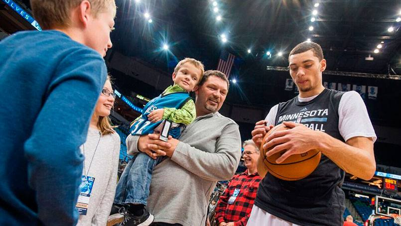 The George kids are kids captains for Mayo Clinic night at Target Center.