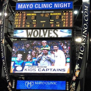 The George family on the Timberwolves' Jumbotron.
