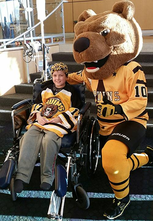 Young cancer patient Jaxon Gorman spirits were raised by a visit from the Austin Bruins.