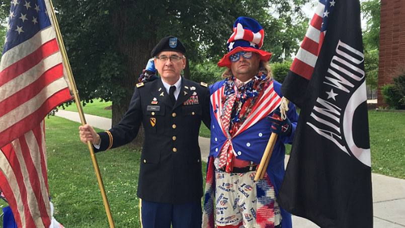 Dr. Walter Franz joined Joe Johnson on Second Street to wave the flag on the Fourth of July.