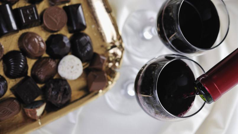Red wine and dark chocolate may not only be the way to your loved one's heart, they also each hold benefits for their hearts, when consumed in moderation.