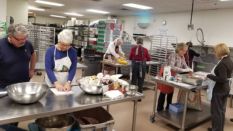 Mayo Clinic Hospice volunteers came together to bake Christmas cookies for hospice patients who are no longer able to.