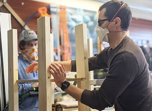 Carving out comfort: Resident's woodworking hobby provides desks for kids in need